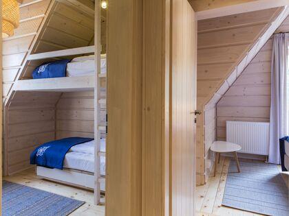 apartament 1050 West 2 Kościelisko 2 zamykana sypialnia z łóżkiem piętrowym.