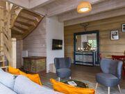apartament 1050 West 2 Kościelisko Salon z częścią wypoczynkową oraz jadalną.