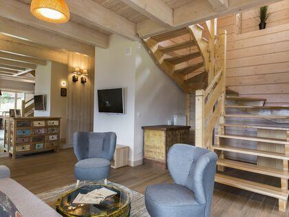 apartament 1050 West 1 Kościelisko Salon z wejściem do sypialni na górze.