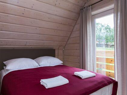 apartment 1050 West 1 Kościelisko 3 zamykana sypialnia z wyjściem na balkon - wschód.