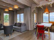 apartment 1050 West 1 Kościelisko Salon z częścią wypoczynkową oraz jadalną.