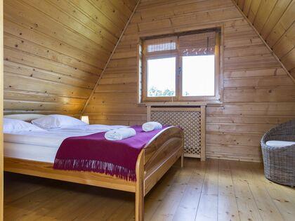 apartament Białka Garden 3 Białka Tatrzańska 1 zamykana sypialnia z łóżkiem małżeńskim.